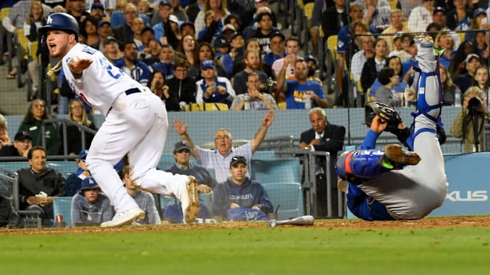 LOS ANGELES, CA - JUNE 14: Alex Verdugo #27 of the Los Angeles Dodgers is safe at home as he beats the throw to Willson Contreras #40 of the Chicago Cubs in the fifth inning of the game Dodger Stadium on June 14, 2019 in Los Angeles, California. (Photo by Jayne Kamin-Oncea/Getty Images)