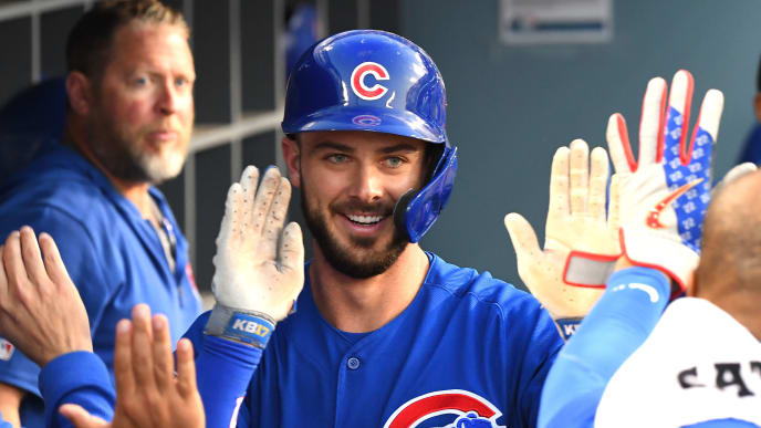 LOS ANGELES, CA - JUNE 14: Kris Bryant #17 of the Chicago Cubs is  congratulated in the dugout after hitting a solo home run in the third inning of the game against the Los Angeles Dodgers at Dodger Stadium on June 14, 2019 in Los Angeles, California. (Photo by Jayne Kamin-Oncea/Getty Images)