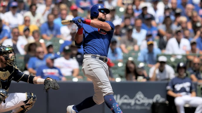MILWAUKEE, WISCONSIN - JULY 28:  Kyle Schwarber #12 of the Chicago Cubs hits a grand slam in the second inning against the Milwaukee Brewers at Miller Park on July 28, 2019 in Milwaukee, Wisconsin. (Photo by Dylan Buell/Getty Images)