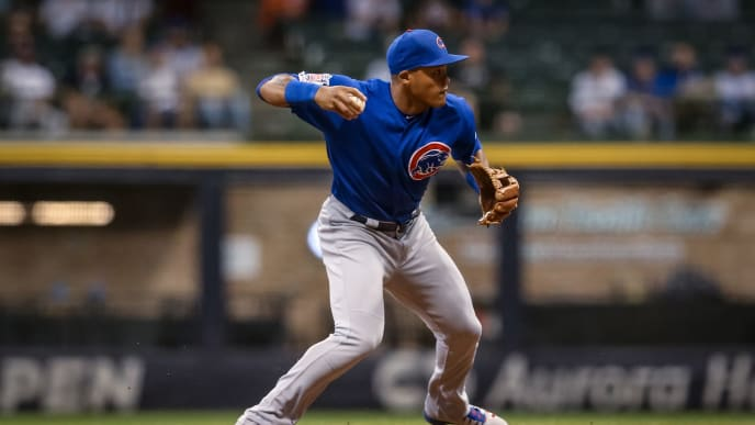 MILWAUKEE, WISCONSIN - SEPTEMBER 05:  Addison Russell #27 of the Chicago Cubs attempts to turn a double play in the ninth inning against the Milwaukee Brewers at Miller Park on September 05, 2019 in Milwaukee, Wisconsin. (Photo by Dylan Buell/Getty Images)