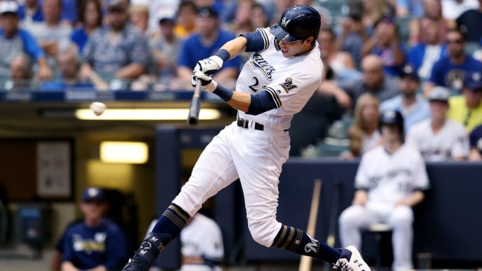 MILWAUKEE, WISCONSIN - JULY 27:  Christian Yelich #22 of the Milwaukee Brewers hits a single in the sixth inning against the Chicago Cubs at Miller Park on July 27, 2019 in Milwaukee, Wisconsin. (Photo by Dylan Buell/Getty Images)