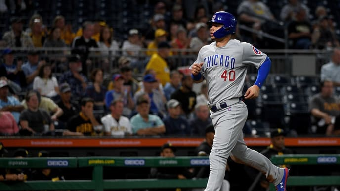 PITTSBURGH, PA - SEPTEMBER 25: Willson Contreras #40 of the Chicago Cubs comes around to score on an RBI single by Ian Happ #8 in the second inning during the game against the Pittsburgh Pirates at PNC Park on September 25, 2019 in Pittsburgh, Pennsylvania. (Photo by Justin Berl/Getty Images)