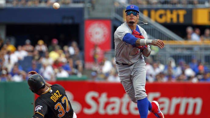 PITTSBURGH, PA - AUGUST 17:  Javier Baez #9 of the Chicago Cubs turns a double play against the Pittsburgh Pirates in the second inning at PNC Park on August 17, 2019 in Pittsburgh, Pennsylvania.  (Photo by Justin K. Aller/Getty Images)