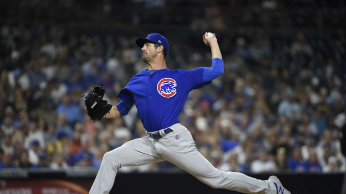 Cole Hamels, then with the Chicago Cubs, joins the Atlanta Braves