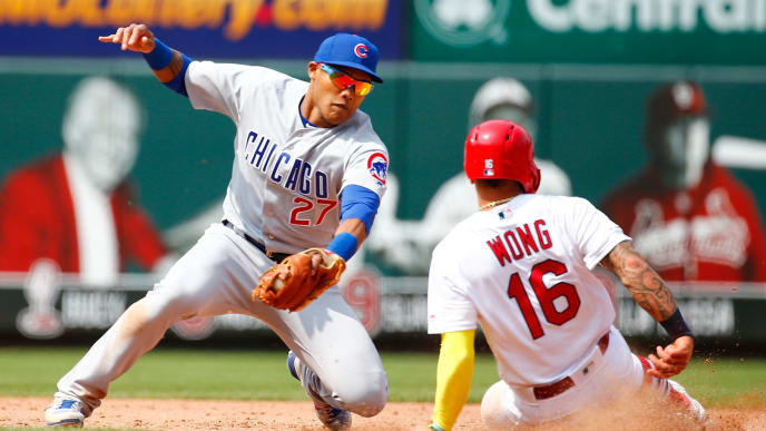 ST LOUIS, MO - JUNE 02: Kolten Wong #16 of the St. Louis Cardinals steals second base against Addison Russell #27 of the Chicago Cubs in the eighth inning at Busch Stadium on June 2, 2019 in St Louis, Missouri. (Photo by Dilip Vishwanat/Getty Images)