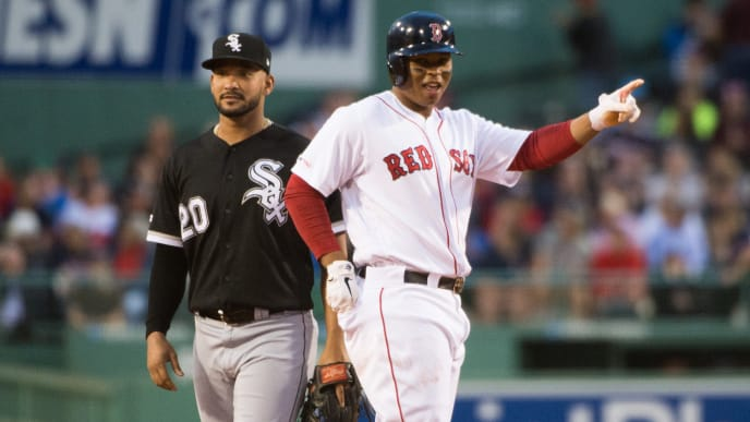 BOSTON, MA - JUNE 25: Rafael Devers #11 of the Boston Red Sox reacts after hitting a RBI double in the first inning against the Chicago White Sox at Fenway Park on June 25, 2019 in Boston, Massachusetts. (Photo by Kathryn Riley/Getty Images)