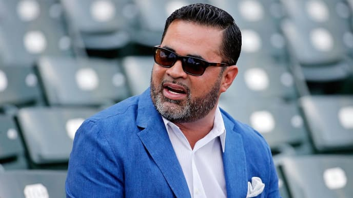 CHICAGO, IL - JULY 27: Ozzie Guillen, former manager of the Chicago White Sox, sits in the stands before the game between the Chicago White Sox and the Chicago Cubs at Wrigley Field on July 27, 2016 in Chicago, Illinois.  (Photo by Jon Durr/Getty Images)