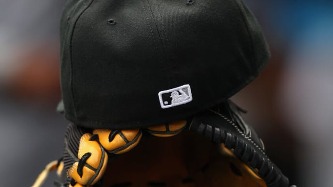 DENVER, CO - APRIL 09:  A cap and glove lies in the Chicago White Sox dugout awaiting action against the Colorado Rockies during Interleague play at Coors Field on April 9, 2014 in Denver, Colorado. The Rockies defeated the White Sox 10-4.  (Photo by Doug Pensinger/Getty Images)