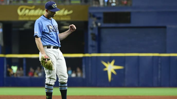 ST. PETERSBURG, FLORIDA - JULY 21: Adam Kolarek #56 of the Tampa Bay Rays reacts after the last out of a 4-2 win over the Chicago White Sox at Tropicana Field on July 21, 2019 in St. Petersburg, Florida. (Photo by Julio Aguilar/Getty Images)
