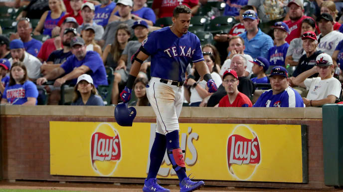 ARLINGTON, TEXAS - JUNE 22: Ronald Guzman #11 of the Texas Rangers limps off the field after grounding out against the Chicago White Sox in the bottom of the eighth inning at Globe Life Park in Arlington on June 22, 2019 in Arlington, Texas. (Photo by Tom Pennington/Getty Images)