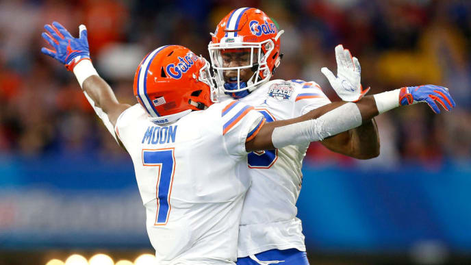 ATLANTA, GEORGIA - DECEMBER 29:  Jeremiah Moon #7 and Chauncey Gardner-Johnson #23 of the Florida Gators celebrate a stopage on fourth down in the first quarter against the Michigan Wolverines during the Chick-fil-A Peach Bowl at Mercedes-Benz Stadium on December 29, 2018 in Atlanta, Georgia. (Photo by Mike Zarrilli/Getty Images)