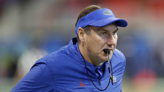 ATLANTA, GEORGIA - DECEMBER 29:  Head coach Dan Mullen of the Florida Gators looks on during warm ups prior to the Chick-fil-A Peach Bowl against the Michigan Wolverines at Mercedes-Benz Stadium on December 29, 2018 in Atlanta, Georgia. (Photo by Joe Robbins/Getty Images)