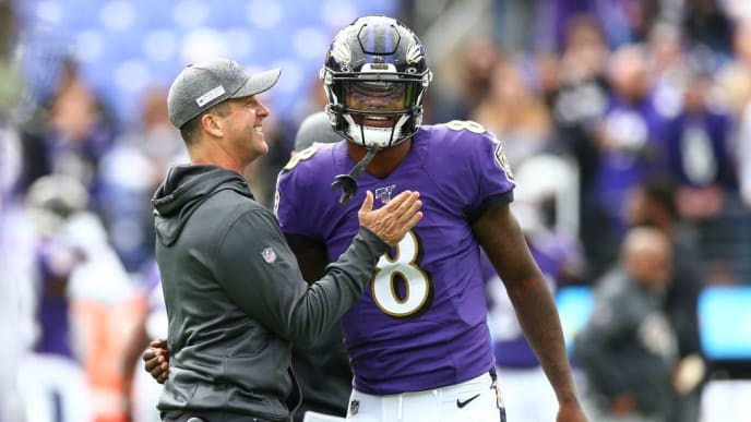 BALTIMORE, MD - OCTOBER 13: Head coach John Harbaugh interacts with Lamar Jackson #8 of the Baltimore Ravens prior to playing against the Cincinnati Bengals at M&T Bank Stadium on October 13, 2019 in Baltimore, Maryland. (Photo by Dan Kubus/Getty Images)