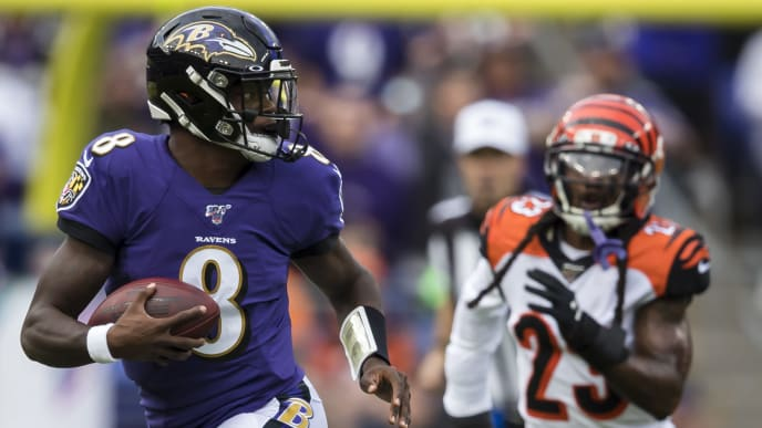 BALTIMORE, MD - OCTOBER 13: Lamar Jackson #8 of the Baltimore Ravens scrambles against the Cincinnati Bengals during the first half at M&T Bank Stadium on October 13, 2019 in Baltimore, Maryland. (Photo by Scott Taetsch/Getty Images)