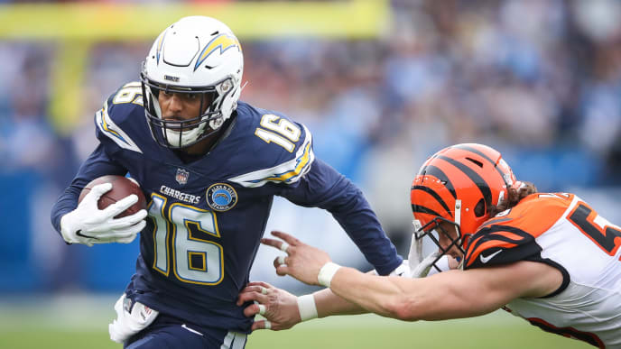 CARSON, CA - DECEMBER 09: Wide receiver Tyrell Williams #16 of the Los Angeles Chargers makes a pass play in front of outside linebacker Nick Vigil #59 of the Cincinnati Bengals in the fourth quarter at StubHub Center on December 9, 2018 in Carson, California. (Photo by Sean M. Haffey/Getty Images)