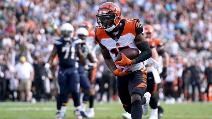 CARSON, CA - DECEMBER 09:  John Ross #15 of the Cincinnati Bengals run in after his catch for a touchdown, to trail 14-12 to the Los Angeles Chargers, during the second quarter at StubHub Center on December 9, 2018 in Carson, California.  (Photo by Harry How/Getty Images)