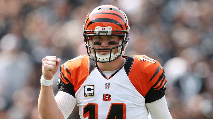 OAKLAND, CA - SEPTEMBER 13:  Andy Dalton #14 of the Cincinnati Bengals celebrates after a touchdown against the Oakland Raiders during the first half of their NFL game at O.co Coliseum on September 13, 2015 in Oakland, California.  (Photo by Ezra Shaw/Getty Images)