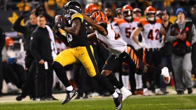 PITTSBURGH, PA - DECEMBER 30: James Washington #13 of the Pittsburgh Steelers makes a catch as Tony McRae #29 of the Cincinnati Bengals defends in the third quarter during the game at Heinz Field on December 30, 2018 in Pittsburgh, Pennsylvania. (Photo by Joe Sargent/Getty Images)