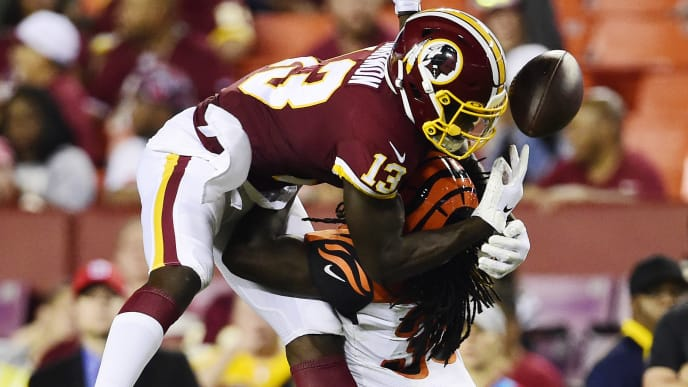 LANDOVER, MD - AUGUST 15: Kelvin Harmon #13 of the Washington Redskins is called for offensive interference against Davontae Harris #35 of the Cincinnati Bengals in the fourth quarter during a preseason game at FedExField on August 15, 2019 in Landover, Maryland. (Photo by Patrick McDermott/Getty Images)