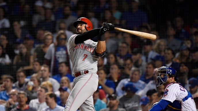CHICAGO, ILLINOIS - SEPTEMBER 18: Eugenio Suarez #7 of the Cincinnati Reds hits a home run in the fourth inning against the Chicago Cubs at Wrigley Field on September 18, 2019 in Chicago, Illinois. (Photo by Quinn Harris/Getty Images)