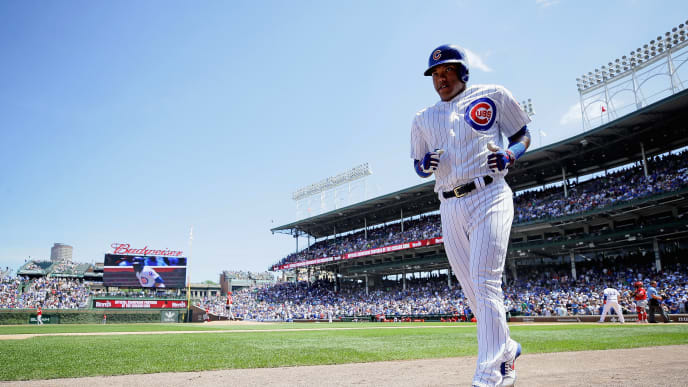 CHICAGO, ILLINOIS - JULY 17: Addison Russell #27 of the Chicago Cubs trots to the dugout after hitting a solo home run in the 2nd inning against the Cincinnati Reds at Wrigley Field on July 17, 2019 in Chicago, Illinois. (Photo by Jonathan Daniel/Getty Images)