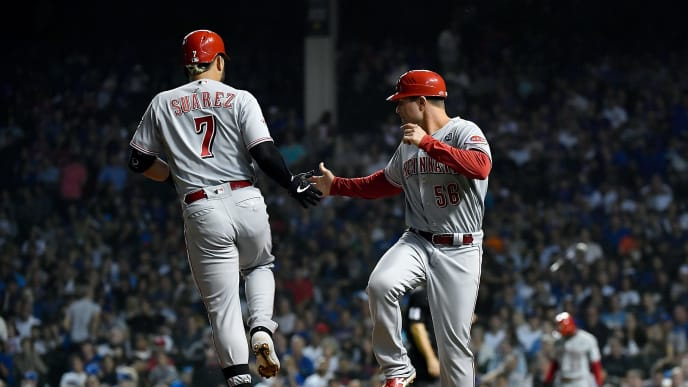 CHICAGO, ILLINOIS - SEPTEMBER 18: J.R. House #56 of the Cincinnati Reds high fives Eugenio Suarez #7 of the Cincinnati Reds for his home run in the fourth inning against the Chicago Cubs at Wrigley Field on September 18, 2019 in Chicago, Illinois. (Photo by Quinn Harris/Getty Images)