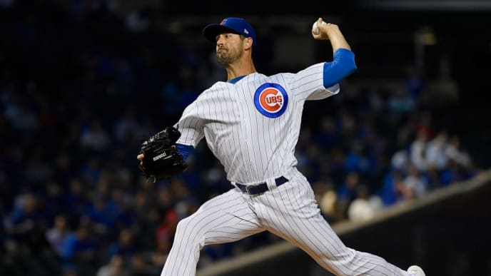 CHICAGO, ILLINOIS - SEPTEMBER 16: Starting pitcher Cole Hamels #35 of the Chicago Cubs delivers the ball in the first inning against the Cincinnati Reds at Wrigley Field on September 16, 2019 in Chicago, Illinois. (Photo by Quinn Harris/Getty Images)