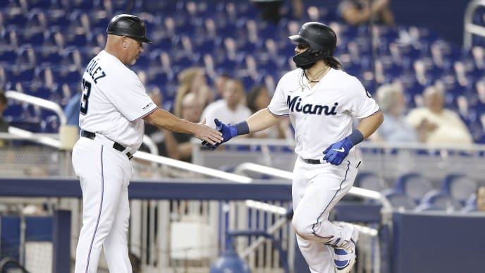 MIAMI, FLORIDA - AUGUST 27:  Jorge Alfaro #38 of the Miami Marlins celebrates with third base coach Fredi Gonzalez #33 after hitting a two-run home run against the Cincinnati Reds at Marlins Park on August 27, 2019 in Miami, Florida. (Photo by Michael Reaves/Getty Images)