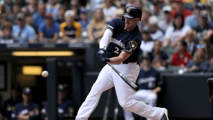 MILWAUKEE, WISCONSIN - JUNE 22:  Travis Shaw #21 of the Milwaukee Brewers grounds into a fielder's choice in the first inning against the Cincinnati Reds at Miller Park on June 22, 2019 in Milwaukee, Wisconsin. (Photo by Dylan Buell/Getty Images)