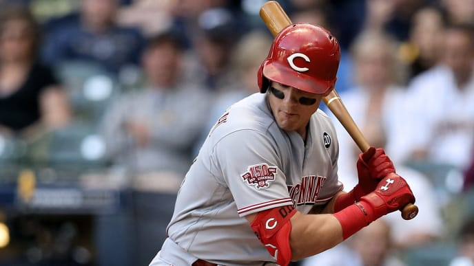 MILWAUKEE, WISCONSIN - JUNE 20:  Derek Dietrich #22 of the Cincinnati Reds is hit by a pitch in the first inning against the Milwaukee Brewers at Miller Park on June 20, 2019 in Milwaukee, Wisconsin. (Photo by Dylan Buell/Getty Images)
