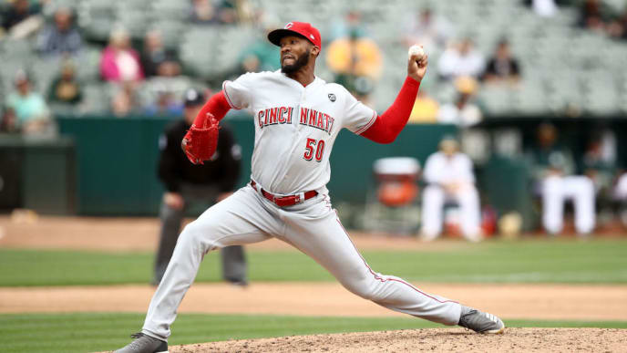 OAKLAND, CALIFORNIA - MAY 09:  Amir Garrett #50 of the Cincinnati Reds pitches against the Cincinnati Reds at Oakland-Alameda County Coliseum on May 09, 2019 in Oakland, California. (Photo by Ezra Shaw/Getty Images)