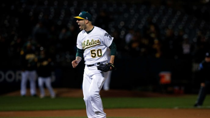 OAKLAND, CA - MAY 07: Mike Fiers #50 of the Oakland Athletics celebrates after pitching a no hitter against the Cincinnati Reds at the Oakland Coliseum on May 7, 2019 in Oakland, California. The Oakland Athletics defeated the Cincinnati Reds 2-0. (Photo by Jason O. Watson/Getty Images)