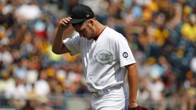 PITTSBURGH, PA - AUGUST 25:  Trevor Bauer #27 of the Cincinnati Reds reacts in the second inning against the Pittsburgh Pirates at PNC Park on August 25, 2019 in Pittsburgh, Pennsylvania. Teams are wearing special color schemed uniforms with players choosing nicknames to display for Players' Weekend. (Photo by Justin K. Aller/Getty Images)