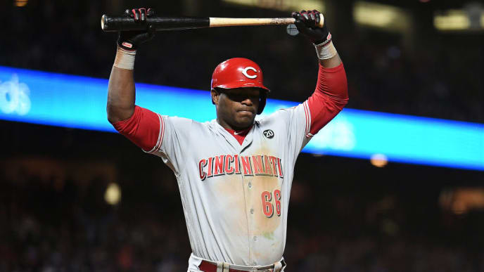 SAN FRANCISCO, CALIFORNIA - MAY 11: Yasiel Puig #66 of the Cincinnati Reds reacts after striking out against the San Francisco Giants during their MLB game at Oracle Park on May 11, 2019 in San Francisco, California. (Photo by Robert Reiners/Getty Images)
