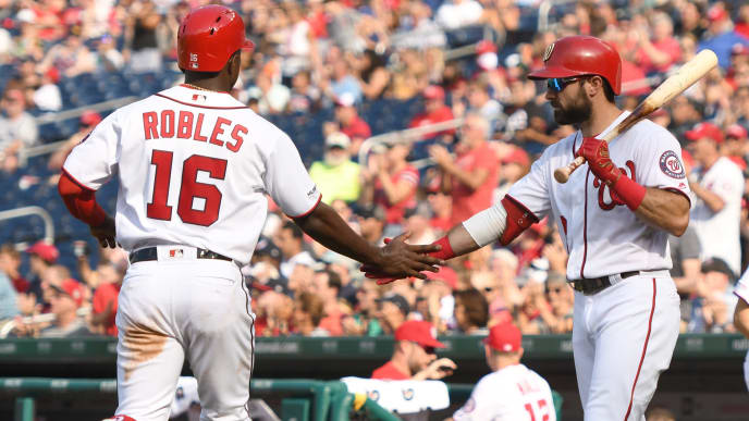 WASHINGTON, DC - AUGUST 14:  Victor Robles #16 of the Washington Nationals celebrates scoring a run with Adam Eaton #2 on a Trea Turner #7 sac fly in the third inning  during a baseball game against the Cincinnati Reds at Nationals Park on August 14, 2019 in Washington, DC.  (Photo by Mitchell Layton/Getty Images)