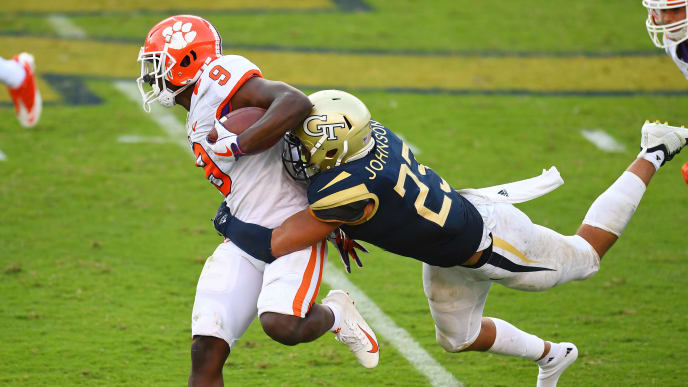 ATLANTA, GA - SEPTEMBER 22: Travis Etienne #9 of the Clemson Tigers carries the ball against Jalen Johnson #23 of the Georgia Tech Yellow Jackets on September 22, 2018 in Atlanta, Georgia. (Photo by Scott Cunningham/Getty Images)