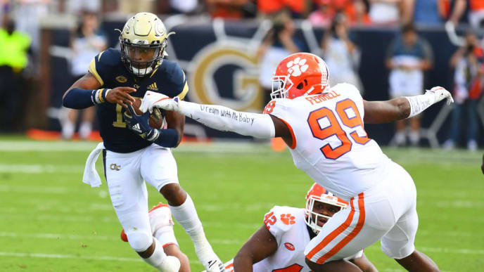 ATLANTA, GA - SEPTEMBER 22: TaQuon Marshall #16 of the Georgia Tech Yellow Jackets carries the ball against Clelin Ferrell #99 of the Clemson Tigers on September 22, 2018 in Atlanta, Georgia. (Photo by Scott Cunningham/Getty Images)