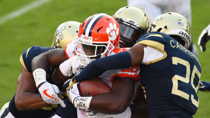 ATLANTA, GA - SEPTEMBER 22: Tariq Carpenter #29 of the Georgia Tech Yellow Jackets attempts to strrip the ball from Tavien Foster #28 of the Clemson Tigers on September 22, 2018 in Atlanta, Georgia. (Photo by Scott Cunningham/Getty Images)