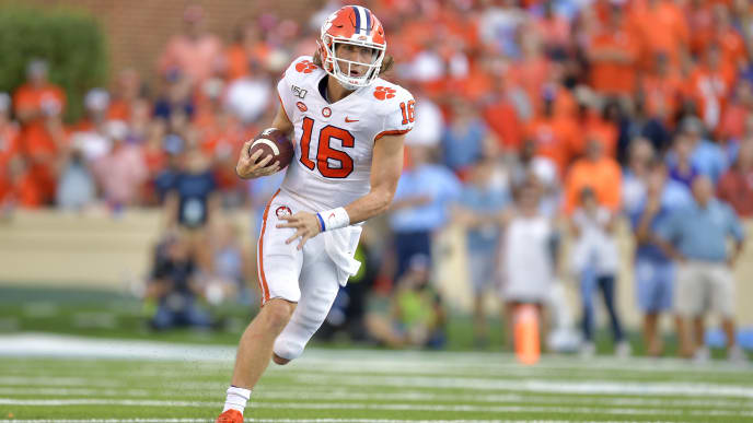 CHAPEL HILL, NORTH CAROLINA - SEPTEMBER 28: Trevor Lawrence #16 of the Clemson Tigers scrambles against the North Carolina Tar Heels during the second half of their game at Kenan Stadium on September 28, 2019 in Chapel Hill, North Carolina. Clemson won 21-20. (Photo by Grant Halverson/Getty Images)
