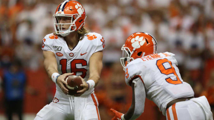 SYRACUSE, NEW YORK - SEPTEMBER 14: Trevor Lawrence #16 attempts to hand the ball to teammate Travis Etienne #9 of the Clemson Tigers at the Carrier Dome on September 14, 2019 in Syracuse, New York. (Photo by Bryan M. Bennett/Getty Images)