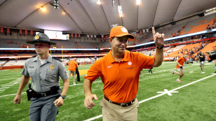 SYRACUSE, NEW YORK - SEPTEMBER 14: Head Coach Dabo Swinney of the Clemson Tigers runs off the field after a game against the Syracuse Orange at the Carrier Dome on September 14, 2019 in Syracuse, New York. (Photo by Bryan M. Bennett/Getty Images)