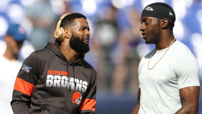 BALTIMORE, MARYLAND - SEPTEMBER 29: Wide receiver Odell Beckham #13 of the Cleveland Browns (L) talks to quarterback Robert Griffin III #3 of the Baltimore Ravens (R) during warm ups before the game at M&T Bank Stadium on September 29, 2019 in Baltimore, Maryland. (Photo by Rob Carr/Getty Images)