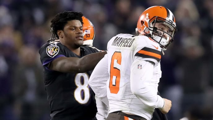 BALTIMORE, MARYLAND - DECEMBER 30: Quarterback Lamar Jackson #8 of the Baltimore Ravens consoles quarterback Baker Mayfield #6 of the Cleveland Browns late in the fourth quarter after Mayfield threw an interception during the Ravens 26-24 win at M&T Bank Stadium on December 30, 2018 in Baltimore, Maryland. (Photo by Rob Carr/Getty Images)