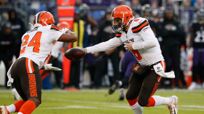 BALTIMORE, MARYLAND - DECEMBER 30: Quarterback Baker Mayfield #6 of the Cleveland Browns hands the ball off to running back Nick Chubb #24 in the first quarter against the Baltimore Ravens at M&T Bank Stadium on December 30, 2018 in Baltimore, Maryland. (Photo by Todd Olszewski/Getty Images)