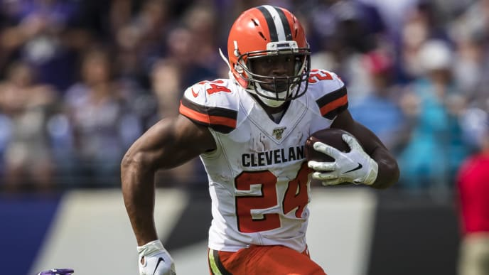 BALTIMORE, MD - SEPTEMBER 29: Nick Chubb #24 of the Cleveland Browns carries the ball against Brandon Carr #24 and Earl Thomas #29 of the Baltimore Ravens during the first half at M&T Bank Stadium on September 29, 2019 in Baltimore, Maryland. (Photo by Scott Taetsch/Getty Images)