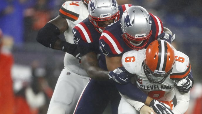 FOXBOROUGH, MASSACHUSETTS - OCTOBER 27:  Quarterback Baker Mayfield #6 of the Cleveland Browns is sacked by Kyle Van Noy #53 of the New England Patriots during the fourth quarter of the game at Gillette Stadium on October 27, 2019 in Foxborough, Massachusetts. (Photo by Omar Rawlings/Getty Images)