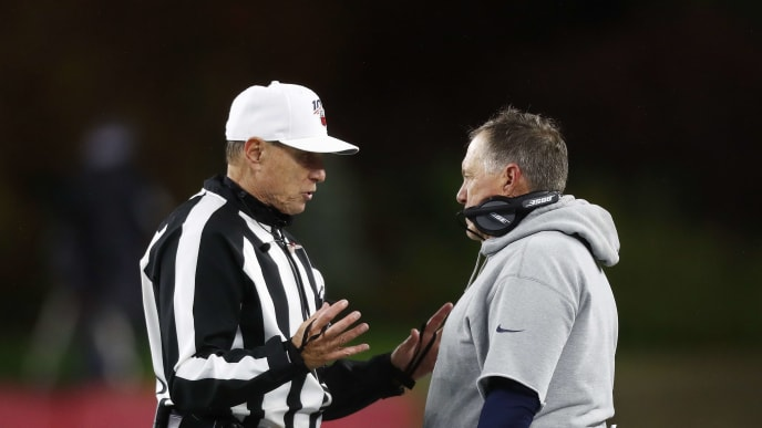 FOXBOROUGH, MASSACHUSETTS - OCTOBER 27: Head coach Bill Belichick of the New England Patriots talks to referee Tony Corrente during the third quarter of the game against the Cleveland Browns at Gillette Stadium on October 27, 2019 in Foxborough, Massachusetts. (Photo by Omar Rawlings/Getty Images)