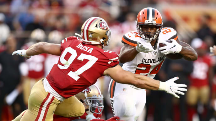 SANTA CLARA, CALIFORNIA - OCTOBER 07:  Nick Chubb #24 of the Cleveland Browns is tackled by Nick Bosa #97 of the San Francisco 49ers at Levi's Stadium on October 07, 2019 in Santa Clara, California. (Photo by Ezra Shaw/Getty Images)