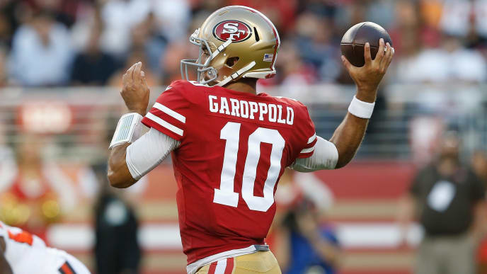SANTA CLARA, CALIFORNIA - OCTOBER 07: Quarterback Jimmy Garoppolo #10 of the San Francisco 49ers looks to pass the ball off in the first half against the Cleveland Browns at Levi's Stadium on October 07, 2019 in Santa Clara, California. (Photo by Lachlan Cunningham/Getty Images)