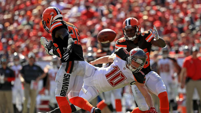 TAMPA, FL - OCTOBER 21: Adam Humphries #10 of the Tampa Bay Buccaneers has a pass broken up by Derrick Kindred #26 and E.J. Gaines #28 of the Cleveland Browns during a game  at Raymond James Stadium on October 21, 2018 in Tampa, Florida.  (Photo by Mike Ehrmann/Getty Images)